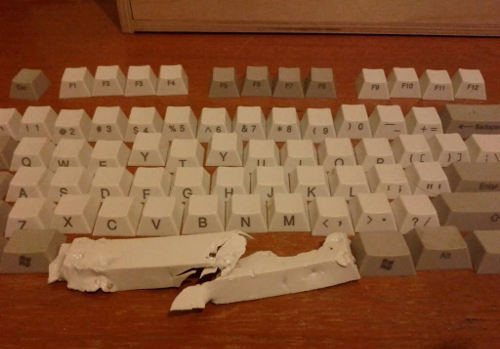 A keyboard with a broken space bar